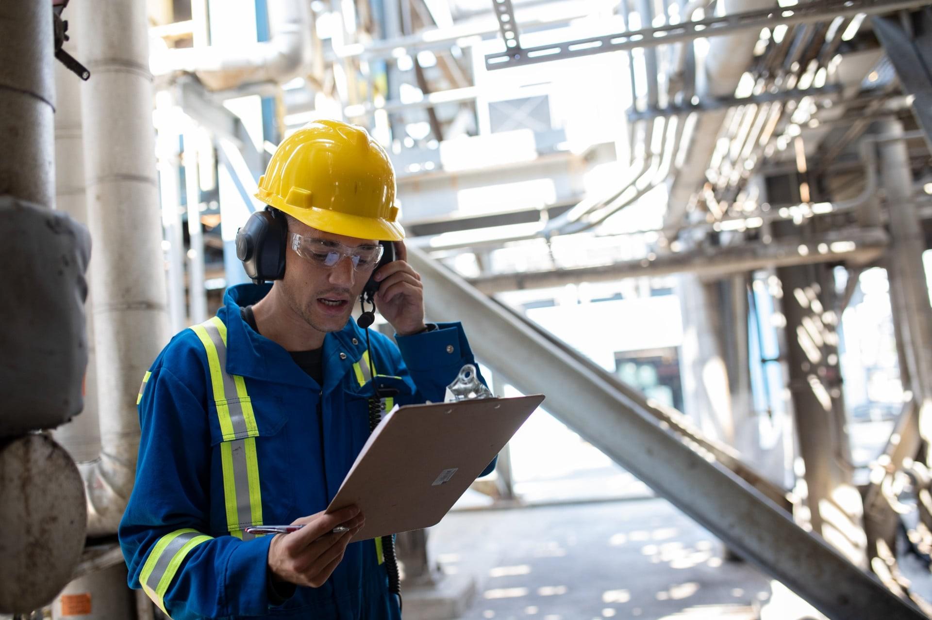 worker using heavy duty headset for intelligent audio
